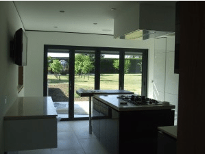 Modern Kitchen with a Bifold Door on the Far Wall