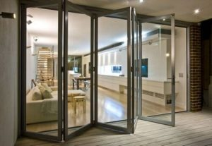 Aluminium Bifold Door Leading from a Decking into a Modern Living Room