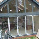 Outside Central View of Bifold Doors with Custom Window