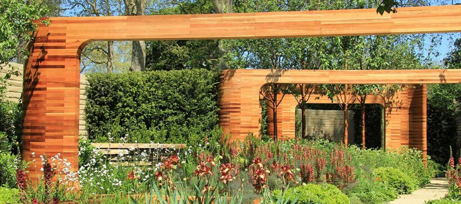 Large Wooden Archways Overhanging Groups of Flowers