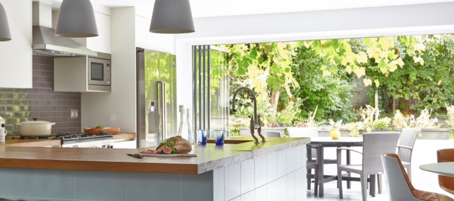 Bifold Doors Leading from a Modern Kitchen out to a Garden